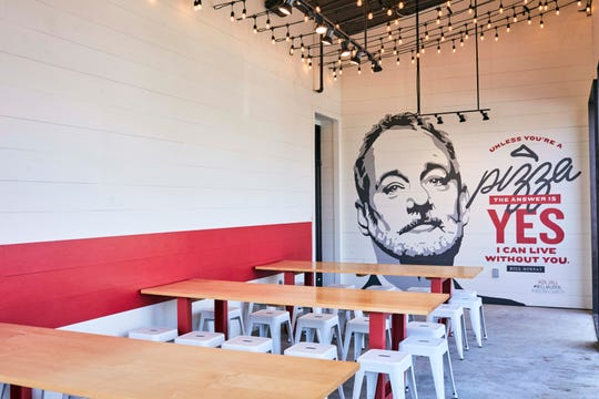 A Bill Murray mural anchors the covered patio at 'Za in Hillsboro Village.