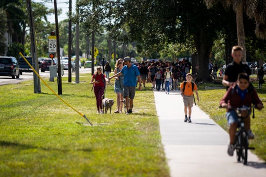 Bonita Springs Middle School students bike and walk home after school along West Terry Street in Bonita Springs on Tuesday, September 24, 2019. The city of Bonita Springs plans to spend $4 million to complete a project replacing the sidewalk along the section of West Terry Street between U.S. 41 and Old 41 Road with a new multi-use path for pedestrians and bicyclists.