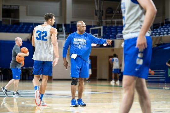 Men's basketball associate head coach Donnie Marsh instructs the team before transitioning into a full-court drill. The FGCU men's and women's basketball teams held their first official practices of the 2019-20 season at Alico Arena on Tuesday, Sept. 24.