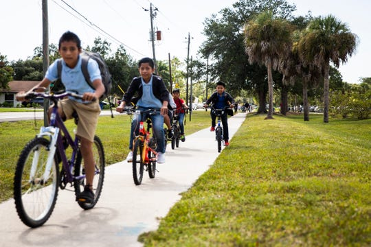 Bonita Springs Middle School students bike home after school along West Terry Street in Bonita Springs on Tuesday, September 24, 2019. The city of Bonita Springs plans to spend $4 million to complete a project replacing the sidewalk along the section of West Terry Street between U.S. 41 and Old 41 Road with a new multi-use path for pedestrians and bicyclists.