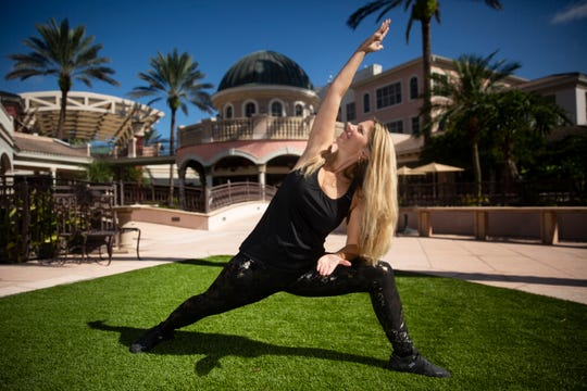 Stephanie McKinley owner of Yes! Yoga, poses for a portriat, Tuesday, Sept. 23, 2019, in Bonita Springs.