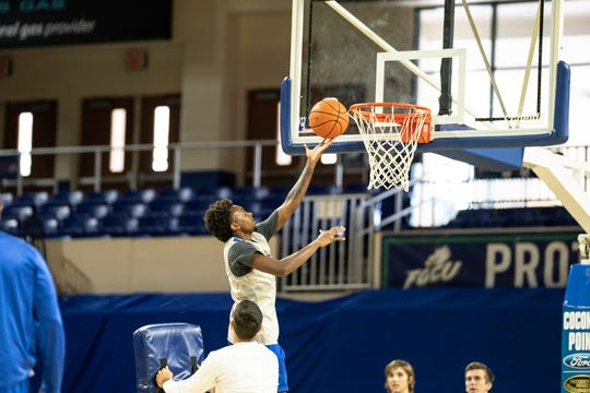 Sophomore Zach Scott blows past assistant coach Joey Cantens holding a pad for a tough lay up. The FGCU men's and women's basketball teams held their first official practices of the 2019-20 season at Alico Arena on Tuesday, Sept. 24.