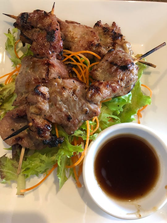Juicy Thai BBQ pork skewers from Tako Boba Tea and Sushi Cafe in North Naples come with a sweet plum dipping sauce.