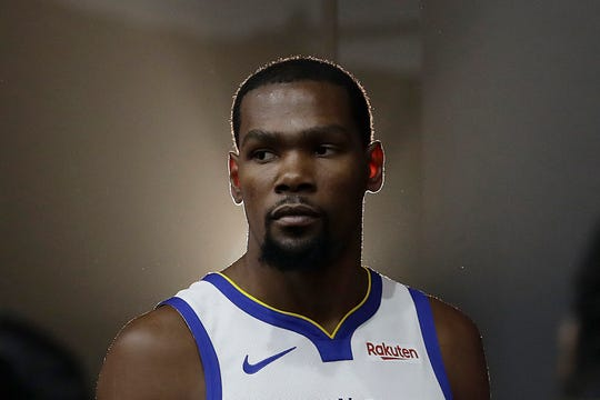 FILE - This is a Sept. 24, 2018, file photo showing then-Golden State Warriors' Kevin Durant posing for photos during media day. Brooklyn Nets general manager Sean Marks says the expectation is Kevin Durant won't play this season, although the All-Star forward will have a say in determining when he's ready. Durant is recovering from surgery to repair a ruptured Achilles tendon.