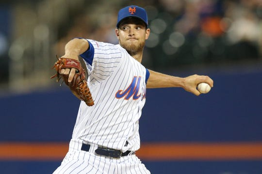 Sep 23, 2019; New York City, NY, USA; New York Mets starting pitcher Steven Matz (32) pitches against the Miami Marlins during the first inning at Citi Field. Mandatory Credit: Brad Penner-USA TODAY Sports