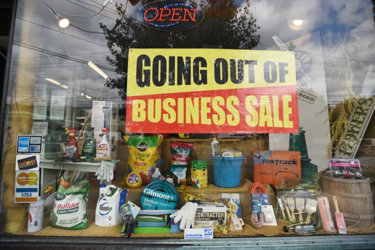 """Sign of """"Going Out of Business"""" is seen outside of the window at the Walker Hardware Store in Totowa, photographed on 09/24/19."""