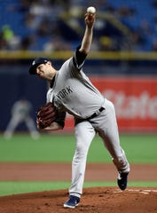 New York Yankees starting pitcher Jordan Montgomery delivers to the Tampa Bay Rays during the first inning of a baseball game Tuesday, Sept. 24, 2019, in St. Petersburg, Fla. (AP Photo/Chris O'Meara)