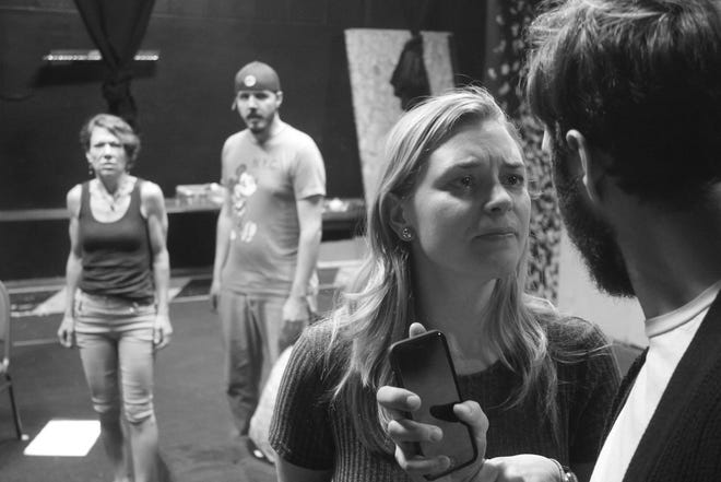 Annette (Sarah Neely) confronts Alan (Josh Martinez) as Michael (Darin Robert Cabot) and Veronica (Nora Brown) look on in a scene from God of Carnage, now rehearsing at The Las Cruces Community Theatre.