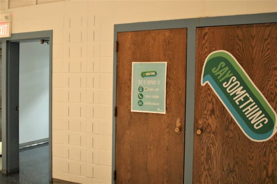 A sign advertising the suicide prevention program in Aztec High School's multipurpose room.