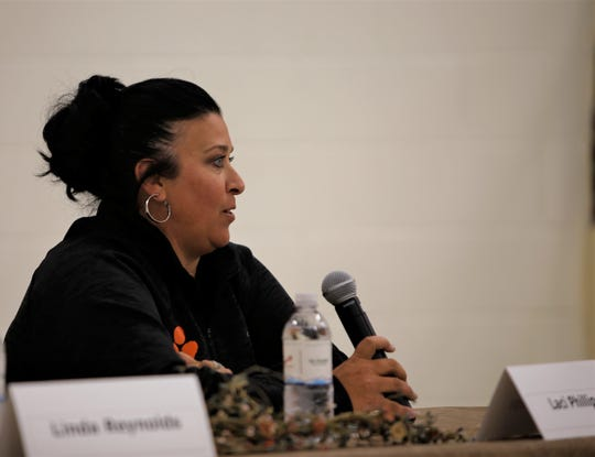 School board candidate Laci Phillips answers a question, Monday, Sept. 23, 2019, during a public forum in Aztec.