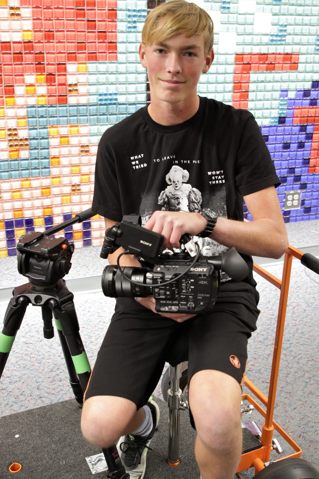 San Juan College student Carl Keller displays a video camera from the school's digital arts program.