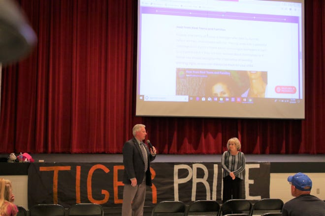 Kirk Carpenter and Glynnis Maes are seen after a presentation on suicide prevention at Aztec High School.