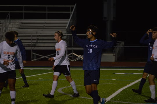 Livonia Stevenson senior forward Shaam Hammami reacts to a shot that nearly went in for the Spartans
