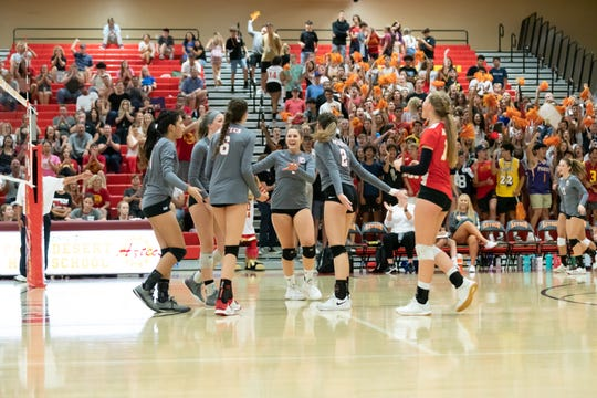 The Aztecs celebrate a point Monday during a 3-0 win over Xavier Prep.