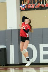 Palm Desert's Molly McCarthy hits a serve Monday against Xavier Prep.