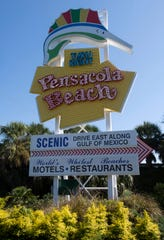 The newly lit Pensacola Beach replacement sign glows brightly following a ceremony Tuesday.