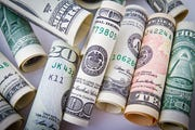 Dollar bills in varying denominations.