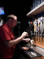 George & Dragon owner David Wimberley demonstrates how to pour a perfect black and tan.