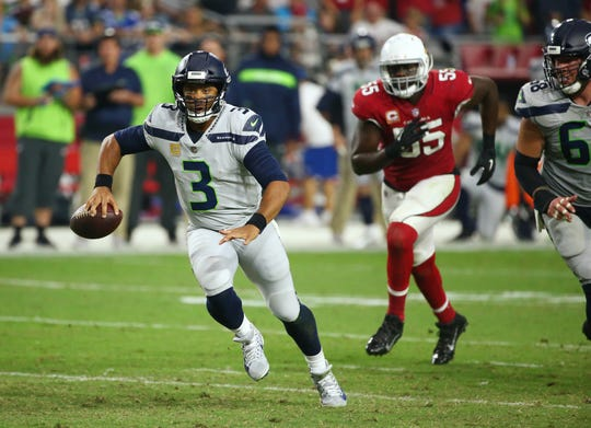 Can the Arizona Cardinals slow down Russell Wilson and the Seattle Seahawks in their Week 4 NFL game? NFL writers weigh in with their predictions.