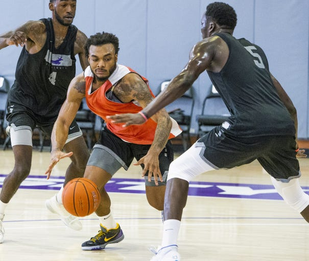 The Grand Canyon University basketball team practices at the school, Tuesday, September 24, 2019.  Guard Carlos Johnson drives.