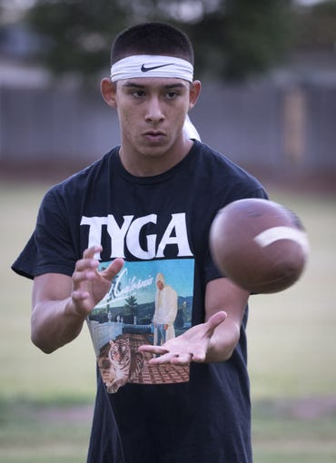 Chris Figueroa catches a ball, September 24, 2019, during practice at the Mesa High School football field, 1630 E. Southern Ave., Mesa.