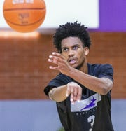 The Grand Canyon University basketball team practices at the school, Tuesday, September 24, 2019.  Guard Mikey Dixon passes.