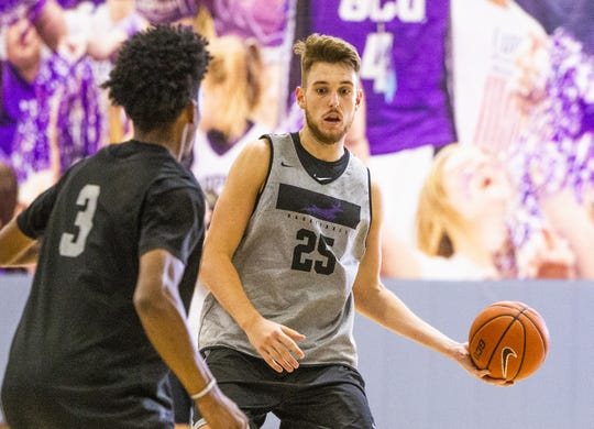 The Grand Canyon University basketball team practices at the school, Tuesday, September 24, 2019. Guard Mikey Dixon, left, and center Alessandro Lever run a drill.
