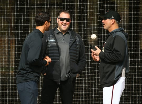 Diamondbacks GM Mike Hazen, senior vice president and assistant GM Jared Porter sand manager Torey Lovullo talk during the first day of spring training workouts on Feb. 13 at Salt River Fields.