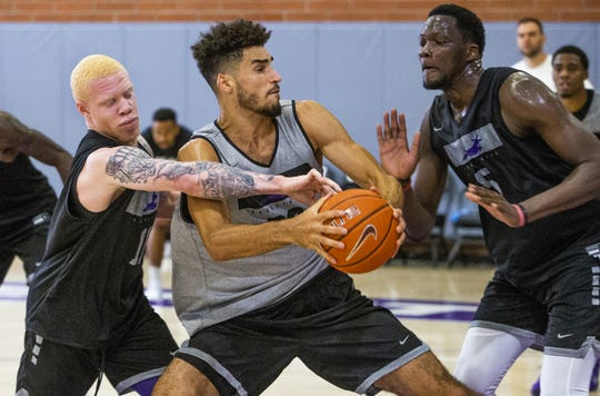 The Grand Canyon University basketball team practices at the school, Tuesday, September 24, 2019. Guard Jaylen Fisher, left, reaches in as forward Gabe McGlothan drives and center Louis Bangai, right, defends.
