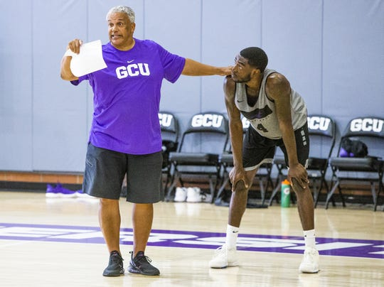The Grand Canyon University basketball team practices at the school, Tuesday, September 24, 2019. Associate Head Coach Marvin Menzies instructs forward Oscar Frayer.