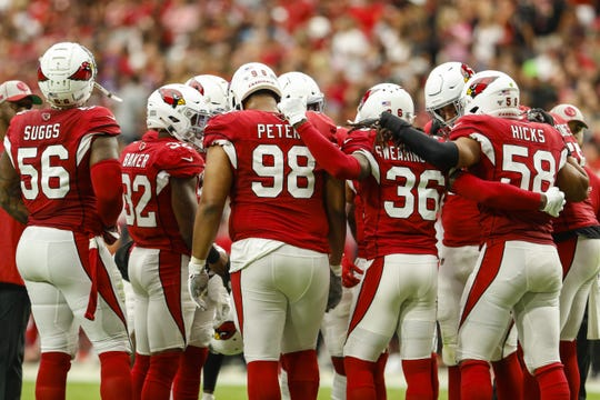 The Arizona Cardinals defense huddles together before a drive during their game against the Carolina Panthers on Sep. 22, 2019 in Glendale, Ariz.