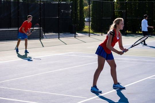 St. Clair junior Quinn Schwarz, left, waits behind his sister Hadley for a serve during a tennis match against Cranbrook Monday, Sept. 23, 2019, at St. Clair High School.