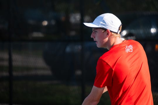 St. Clair senior Eli Pinnoo prepares to serve the ball during a tennis match against Cranbrook Monday, Sept. 23, 2019, at St. Clair High School.