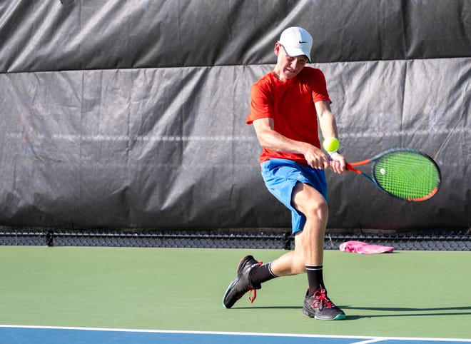 St. Clair sophomore Derek Distelrath goes to return the ball during a tennis match against Cranbrook Monday, Sept. 23, 2019, at St. Clair High School.