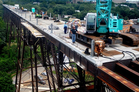 Construction on the Walkway Over the Hudson continues. The cement pads forming the platform on the former Poughkeepsie Railroad Bridge each weigh approximately 30,000 pounds.