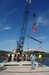 The last 15-ton concrete panel for the Walkway Over the Hudson is set in place by crews on Friday morning, September 4, 2009.