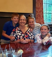 Betsy Wilson, an Arlington High School teacher who was diagnosed with leukemia, poses with three of her children. From left: Johnny, Betsy, Theodosia and Julia Wilson.
