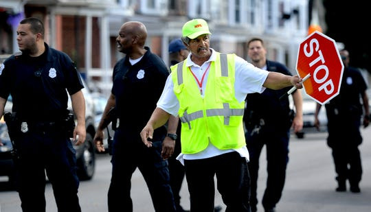 A crossing guard works surrounded by York City Police near McKinley K-8 after a shooting occurred in the 200 block of Kurtz Avenue about 2:15 p.m. Tuesday, Sept. 24, 2019. A female shooting victim was taken by ambulance to York Hospital. The school was placed on lockdown while police investigated. Bill Kalina photo