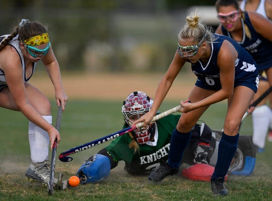 Eastern York goalie Kelsey Felix makes a diving stop on a shot attempt by West York's Madison Rickter last season. Felix has committed to play NCAA Division I field hockey for Lock Haven University. John A. Pavoncello photo