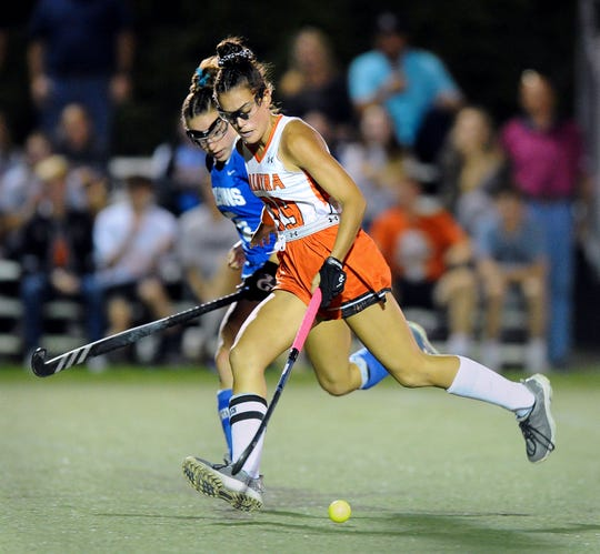 Palmyra's Mia Julian (39) tries to keep control of the ball as she flies down the field during the overtime period in a game between the Palmyra Cougars and the Lower Dauphin Falcons on Sept. 23.