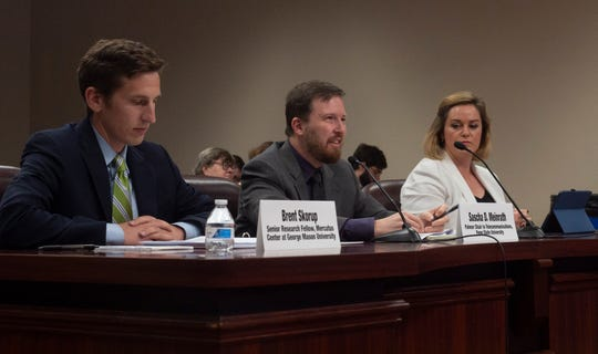 Penn State telecommunications chair Sascha Meinrath (middle) speaks in front of the Pennsylvania Senate Communications and Technology Committee on Monday, Sept. 23, 2019.