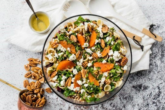Mediterranean pecan pasta salad features chopped nuts and navel oranges that are in season as the weather cools.