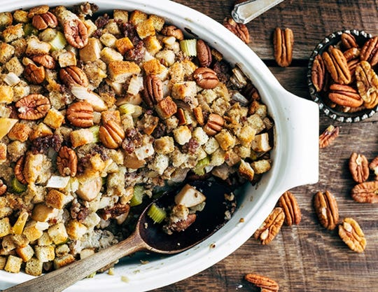 A batch of pecan, apple and sausage stuffing serves 18, making it ideal for Thanksgiving or other holiday gatherings.