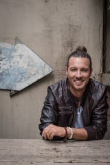"""Country singer Rayne Johnson, known for his singles """"Front Seat"""" and """"Laid Back,"""" will play a free concert at the Cowboy Coast Saloon on Friday, Sept. 27."""