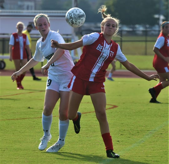 Parkside's Leah Vilov and Bennett's Leigha Early fight for the ball on Monday, Sept. 23, 2019.
