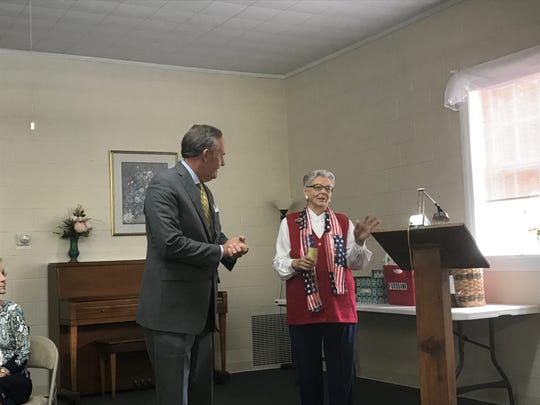 Laura Belle Gordy introduces Sen. Lynwood Lewis at a candidates forum sponsored by the Women's Club of Accomack County in Onley, Virginia on Thursday, Sept. 19, 2019.