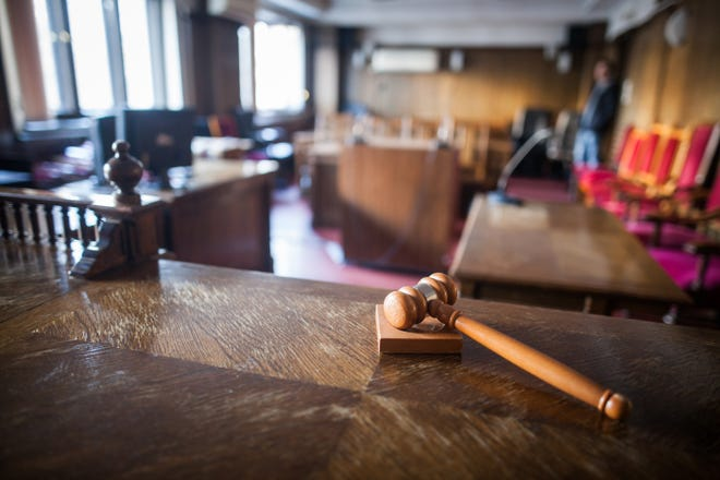 Stock image of courtroom and gavel.
