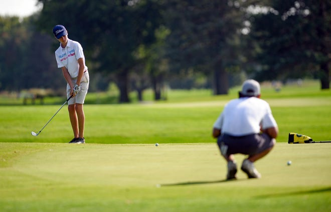 Luke Honner of Lincoln High School putts in the final round of the Boys City Golf meet on Tuesday, September 24, at Elmwood Golf Course in Sioux Falls.