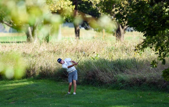 Jack Lundin hits his ball out of the rough in the final round of the Boys City Golf meet on Tuesday, September 24, at Elmwood Golf Course in Sioux Falls.