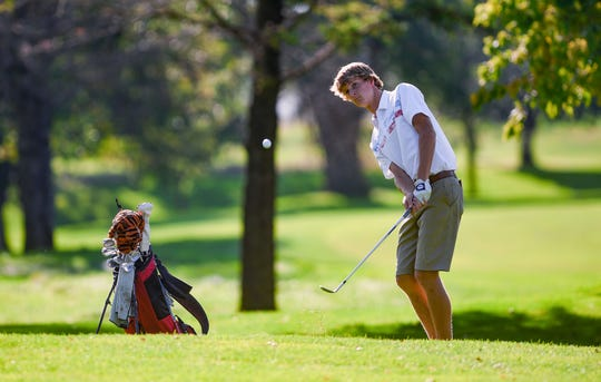 Nash Stenberg of Lincoln High School chips onto the green in the final round of the Boys City Golf meet on Tuesday, September 24, at Elmwood Golf Course in Sioux Falls.